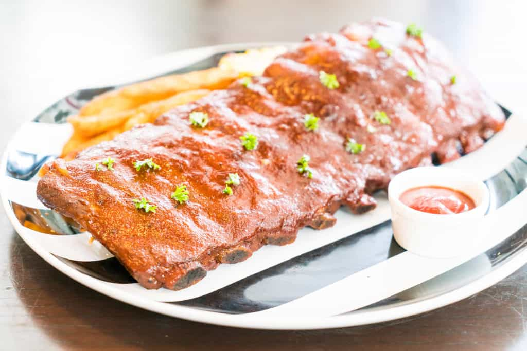 Grilled barbecue ribs pork with sweet sauce on top - soft focus point
